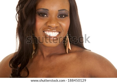 An african American woman with a smile and bare shoulders. - stock photo
