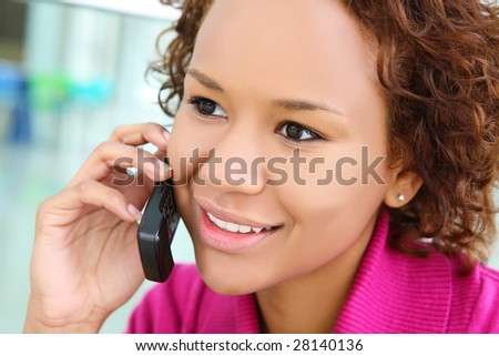 An african american young woman on the cell phone at office