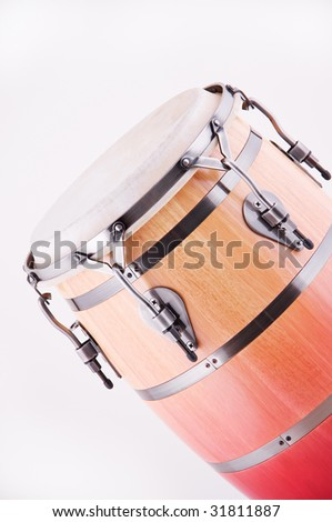 An African conga drum isolated against a white background in the vertical format.