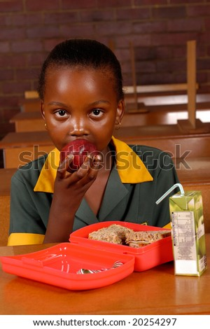 An African student having a healthy lunch - stock photo