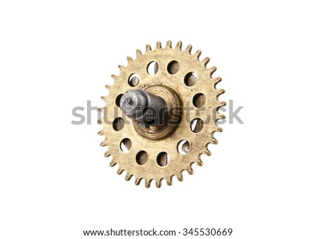 An aged gear from a clock isolated on white background - stock photo