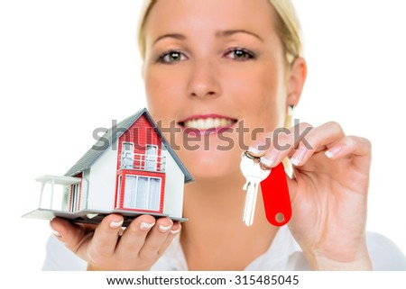 an agent for property with a house and a key. successful leasing and property sales by real estate brokers. - stock photo