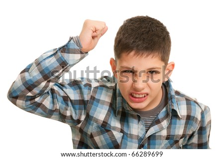 An aggressive guy with his fist risen up attempts to hit; isolated on the white background - stock photo