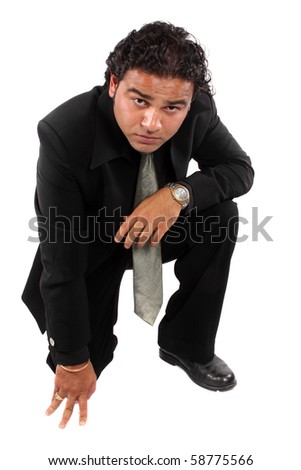 An aggressive Indian businessman, on white studio background. - stock photo