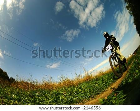 an agresseve mountain biker - stock photo