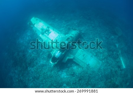 "An Aichi E13A Japanese ""Jake"" sea plane, shot down during World War II, sits on a reef in Palau. Shipwrecks and planes from the war are still being discovered in this remote Micronesian island-nation. - stock photo"