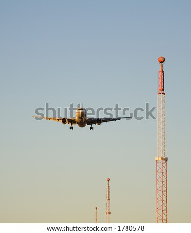 An Airbus 310 and the towers from the Instrument Landing System - stock photo