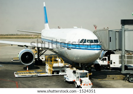 An Airbus waiting for passsengers boarding - stock photo