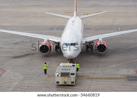 An Aircraft Departing the Gate for Take-off - stock photo