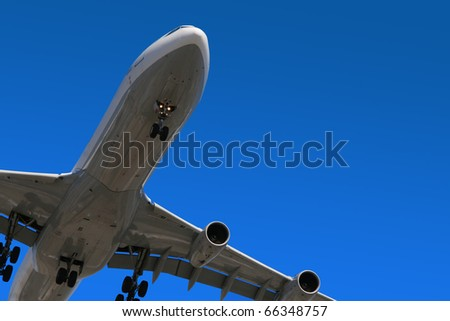 An aircraft on final approach for landing - stock photo