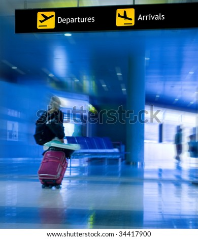 An Airline Passenger Walking in the Airport - stock photo