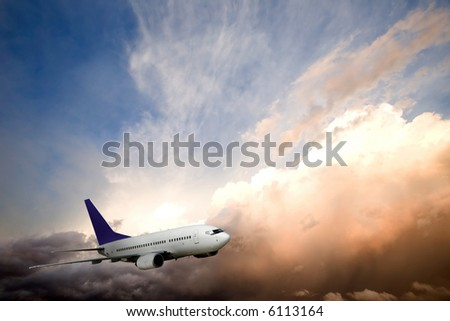 An airliner flying into the sunset