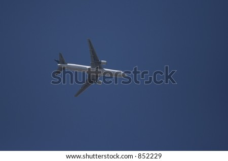 An airliner flying overhead. - stock photo