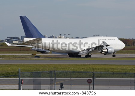 An airliner on a runway. - stock photo