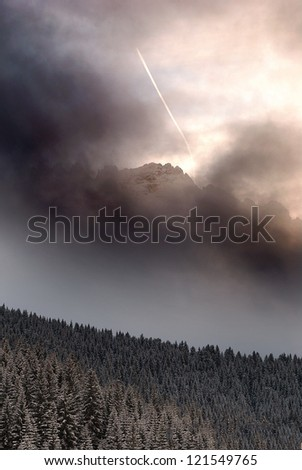 An airplane fly over a peak of latemar, the hearth of the Dolomites in italy