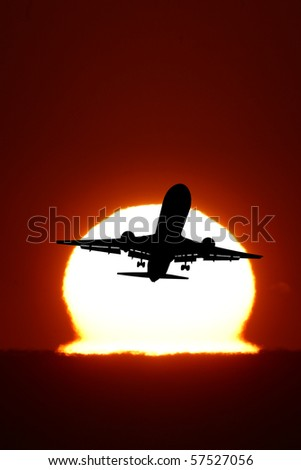 An airplane flying in the sun