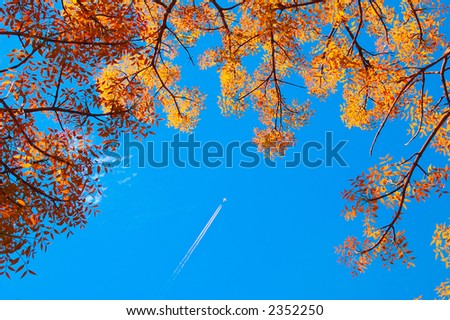 An airplane flying to it's destination - stock photo