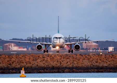 An airplane is seen here in Sydney airport vacating the runway. - stock photo