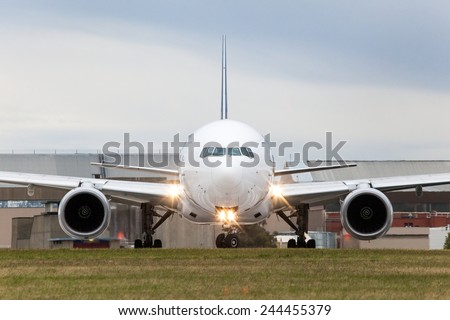 An airplane is seen lining up Melbourne's runway. - stock photo