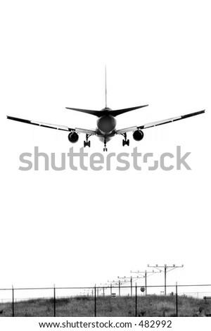 An airplane landing, B&W - stock photo