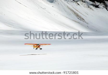 An airplane landing on Aletsch Glacier, Berner Oberland, Switzerland - stock photo