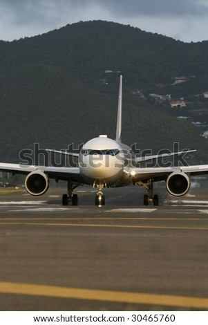 An airplane on the runway - stock photo