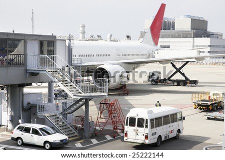An airplane ready for boarding - stock photo