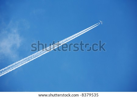 An airplane trail across the sky - stock photo