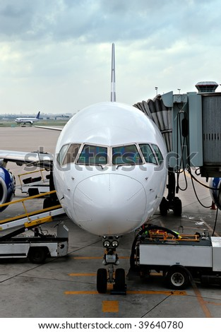An airplane, with the gangway attached getting ready for boarding