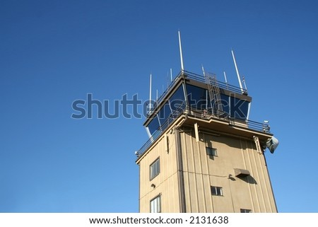 An airport control tower against  blue sky. - stock photo