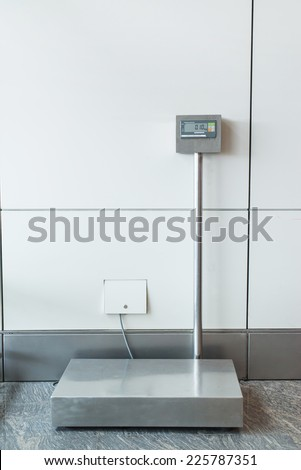 An airport self service check in booth/kiosk with attached baggage scales. - stock photo