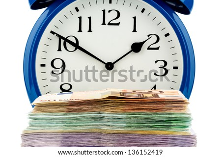 an alarm clock and banknotes, symbolic photo for wage costs, labor costs, working time - stock photo