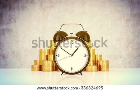 An alarm clock and golden coins are on the table in a room with concrete wall. A concept of time management or billing the services in consulting companies. 3D rendering. Toned image. - stock photo