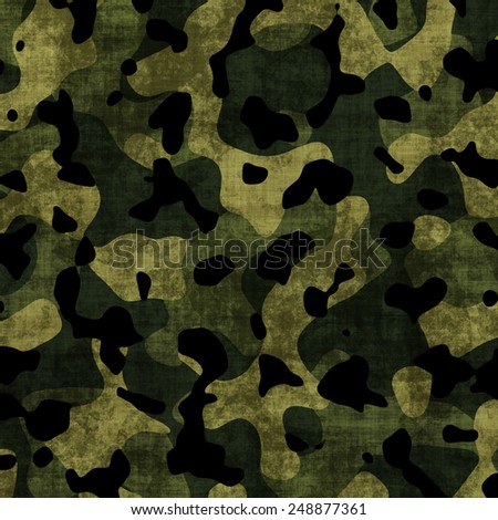 An all purpose, distressed camouflage pattern in beige, green and black for use as a background. - stock photo