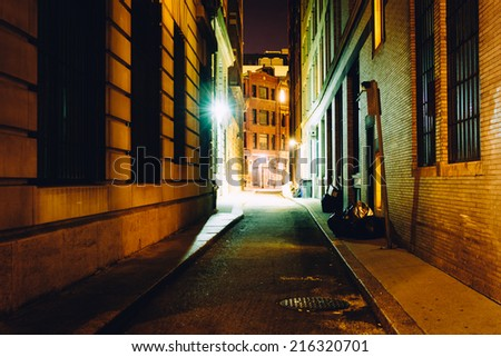 An alley at night, in Boston, Massachusetts. - stock photo