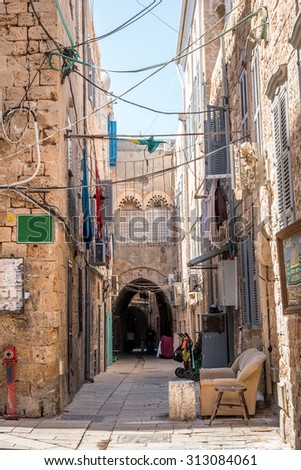 An alley in an ancient old city - stock photo