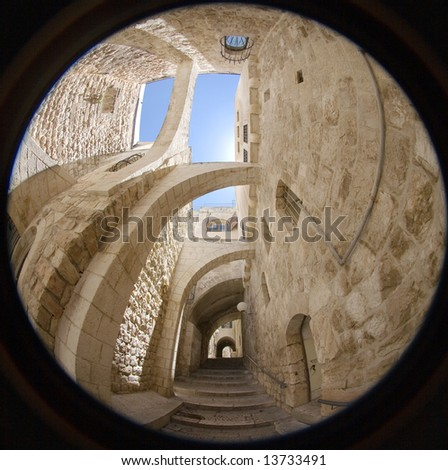 An alley in the old city in Jerusalem. - stock photo