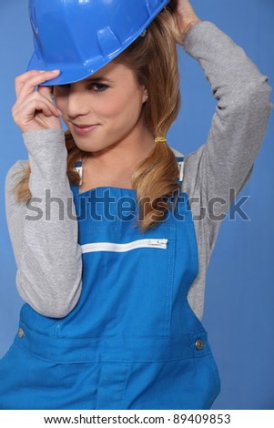 An alluring female construction worker. - stock photo