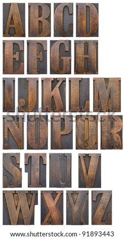An alphabet of wooden printers' blocks silhouetted. - stock photo