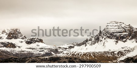 an alpine peak with the first snow of the year - stock photo