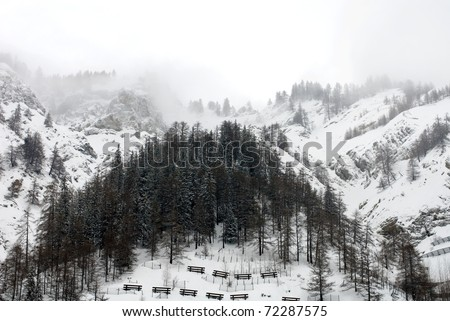 An alpine scene, complete with avalanche barriers, Italy - stock photo