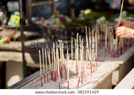 An altar with candles in Grand palace in Bangkok, Thailand. Image with selective focus - stock photo