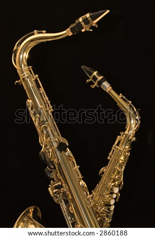 An Alto And  A Tenor Sax On Black Background - stock photo
