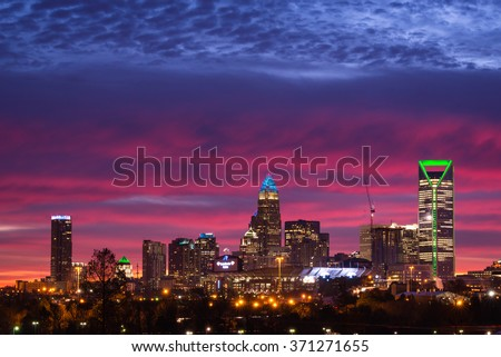 An amazing morning in Charlotte, North Carolina. The colors in the sky were amazing and made the city that much more beautiful the week before the Super Bowl.  - stock photo