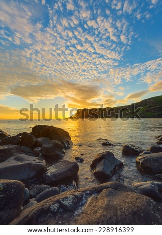 An amazing sunset on the Isle of Skye in Scotland - stock photo