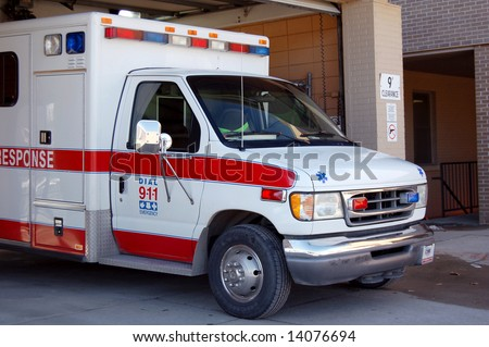 An ambulance parked at a hospital ready to go when needed. - stock photo