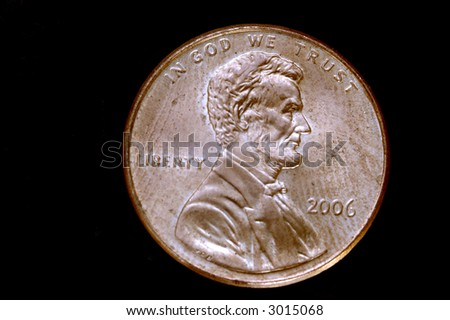 An american coin isolated on a black back ground - stock photo