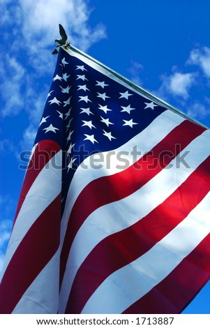 an American flag against a blue sky