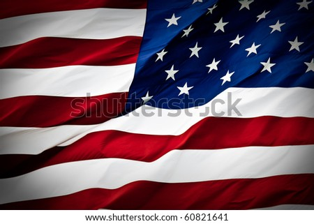 an american flag boldly flying in the wind - stock photo