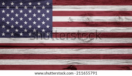 An American flag on a rustic wooden background. - stock photo